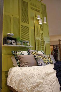 love this shutter wall/headboard idea. floating shelf can also be a shutter.