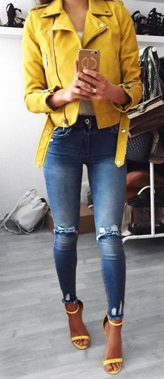 #fall #outfits women's yellow zip-up jacket; blue ripped jeans