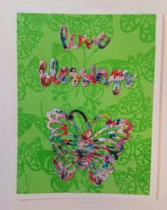 Alcohol ink paper die cut with butterflies and words