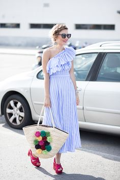 POMPONS – Mi Aventura Con La Moda. Blue striped one shoulder ruffle midi dress+fuchsia knot heeled sandals+raffia colorful pompom basket bag+sunglasses+earrings. Summer Dressy Casual Outfit 2017