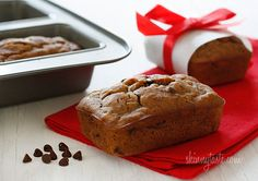 Petite Chocolate Chip Banana Bread Loaves - Whole wheat mini banana bread made with ripe bananas and chocolate chips are sure to leave a smile on anyone's face.