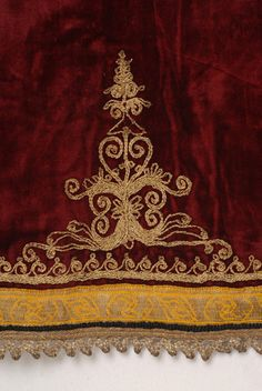 Detail of the decoration at the back bottom of the katifes: embroidered stylized motif and spiral meander, applique gold fillet and lace made of silver thread Embroidery Dress, Embroidery Stitches, Greek Traditional Dress, Greek Costumes, Gypsy Costume, Lace Making, Motifs, Folk Art, Greece