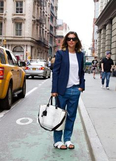 Put-together & totally casual: blazer meets relaxed jeans meets pool slides. #streetstyle