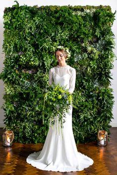 wedding backdrop ideas bride with greenary bouquet