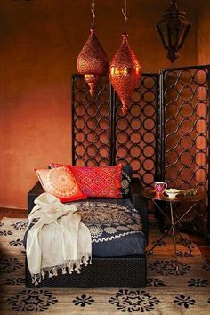 Moroccan style...like the lights, screen and the little tripod tables #MoroccanDecor