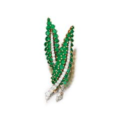 An 18 Karat Gold, Platinum, Emerald and Diamond Brooch, Van Cleef & Arpels, New York, circa 1960, Brooke Astor.