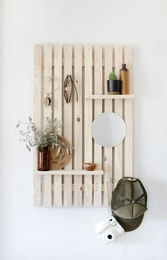 DIY Slat Wall Shelf DIY Wooden Slat Wall Shelf - fill up some empty wall space with this wooden wall shelf perfect for storage and display! Diy Wooden Wall, Wood Slat Wall, Wooden Wall Shelves, Wall Shelves Design, Wooden Slats, Wooden Decor, Corner Shelves, Wooden Shelf Design, Bookshelf Design
