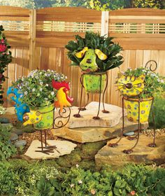Colorful Metal Garden Planter is a fun outdoor accent. Its design and die-cut 3-D metal accents make it stand out on your deck or as part of y