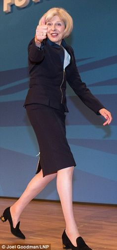 The stern Theresa aflame, melting! Theresa May was so caught up in the effort and force of...