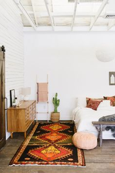 2016 Home Trends Southwest Decor 2016 Home Trends Southwest Decor From graphic prints to bold colors, we can't get enough of southwest decor. Vibrant and colorful Aztec inspired rugs and textiles are the foundation of any Southwest inspired room, while Bohemian Bedroom Decor, Home Decor Bedroom, Bohemian Interior, Bedroom Ideas, Bedroom Décor, Aztec Bedroom, Bedroom Furniture, Furniture Design, Furniture Layout