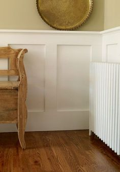 Beef up a wainscot cap so that it doubles as a display shelf. Swap your existing cap for 1x3 trim edged with nose-and-cove molding. The resulting ledge is deep enough for propping family photos. | Photo: David Prince