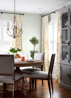 grey hutch. chairs. chandelier