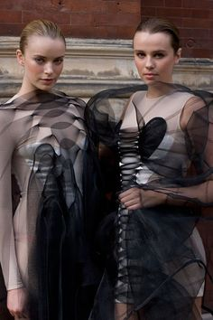 overlapping translucent fabrics to create visible & modest coverage