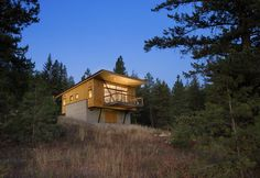 While it was tempting to embed the cabin into the hillside, Balance Associates sought a smarter solution. By elevating the project on two concrete walls, the clients could avoid a costly foundation, improve their view of the landscape, and stay above the thick winter snowfall.