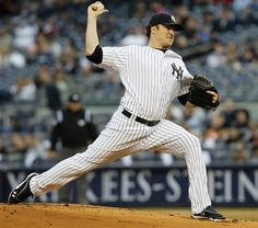 GAME 23: Tuesday, May 1, 2012 - New York Yankees starting pitcher Phil Hughes delivers in the first inning against the Baltimore Orioles during their baseball game at Yankee Stadium in New York. (AP Photo/Kathy Willens)