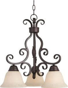 Maxim Lighting 12203FIOI Manor 3-Light Chandelier In Oil Rubbed Bronze With Frosted Ivory Glass is made by the brand Maxim Lighting and is a member of the Manor collection. It has a part number of 12203FIOI.