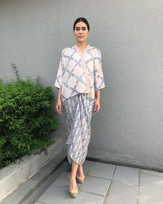 Image may contain: 1 person, standing and outdoor Source by angelinamilj fashion Kaftan Batik, Batik Kebaya, Blouse Batik, Batik Dress, Kebaya Modern Dress, Kebaya Dress, Kebaya Hijab, Modest Fashion, Hijab Fashion