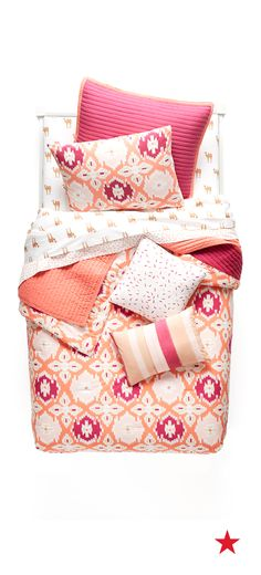 Make the pink & berry colors of this 5-Pc. comforter set from Whim by Martha Stewart your nighttime oasis...if you won't, we sure will!