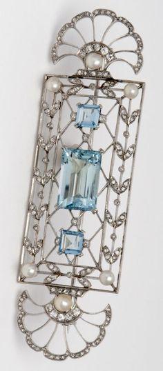 GEORGES FOUQUET – An Art Deco platinum, diamond, natural pearl and aquamarine brooch, circa 1925.
