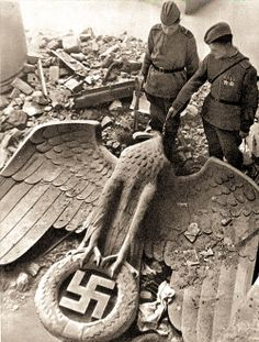 Defeat of the Nazis: two Soviet soldiers stand over a Nazi eagle.e