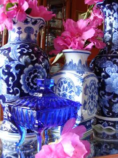 I like blue and white china and blue glass... the flowers should be red, but pink is ok :-D Or for Independence Day, white