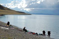Tibetans washing clothes in Lake Namtso, Tibet | by iancowe