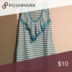 Vneck Ruffle Tank Light blue and white striped. Vneck with ruffle design. Studs around collar. Tops Tank Tops