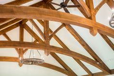 Curved bottom cord trusses for timber frame home Timber Frame Home Plans, Timber Frame Homes, Cord, House Plans, New Homes, Chandelier, Ceiling Lights, Interiors, Home Decor
