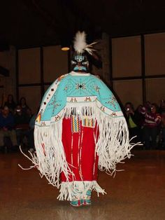 I used to fancy shawl dance from the ages 5-16. I am staring a path ro become an Traditional Dancer. It will be similar to this Picture. Minus the buck skin. I was die from heat..lol