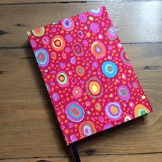 Handmade A6 Notebook Covered in a Cerise Pink Fabric by HandcraftedNotebooks on Etsy
