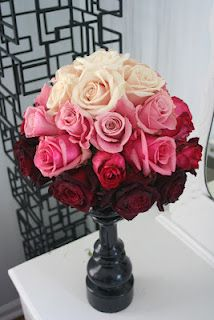 Ombre rose centerpiece, white, pink, red.