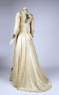 Dress, E Stauffer, New York, ca 1900, silk, Metropolitan Museum of Art, 1979.346.207 The dress is of silk satin trimmed with lace (probably linen), and is shaped almost entirely through the use of pintucks.  Long graduated pintucks in the torso nip in the dress around the waist, and short horizontal pintucks down the front of the sleeves help the sleeves to curve with the arm.