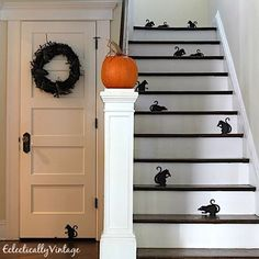 Rats! Trying to frighten small children into dropping their candy so I can eat it all! Think my staircase will scare them? Come over to the blog to see more and how I made that arachnophobia wreath - you have to see it up close and personal - link in profile EclecticallyVintage.com