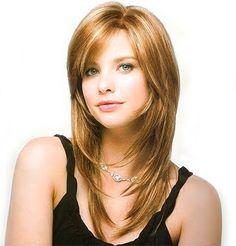 Para cabello más largo, un estilo en capas te hará lucir tu cabello con menos volumen. http://www.gorditosenlucha.com/