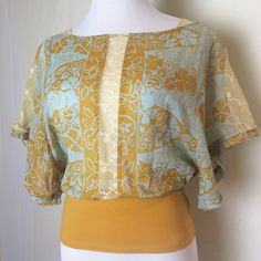Gorgeous FP boho top Wonderful light blue and golden bat wing top with delicate lace accents at shoulders, sleeves and down the front. Excellent condition. Free People Tops