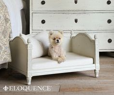 Theodore Dog Bed in Stone Eloquence® Theodore Dog Bed. The perfect bed for your small furry friend! Darling petite scale with hand-carved pinecone finials and fluted column accents.