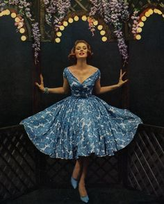 Suzy Parker in a blue and white cocktail dress, 1950s.