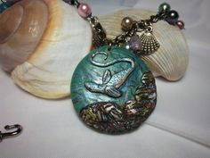 Check out this item in my Etsy shop https://www.etsy.com/listing/94512061/nautical-necklace-sea-serpent-necklace