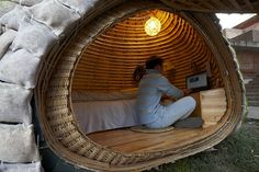 Photos showing the construction of a tiny, off-grid, solar-powered, egg-shaped home in China.