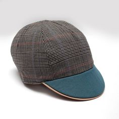 Batch# 1601 Wool Fancy Check This medium-weight reversible cap was designed for the fluctuating temperatures in Bogota and named after the...