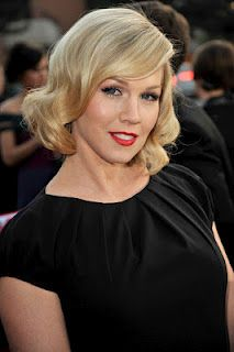 Jennie Garth rocking a vintage look with her hair and makeup.