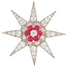 A Victorian ruby and diamond star brooch, set to the centre with an old brilliant-cut diamond surrounded by six round faceted rubies, the rubies estimated to weigh a total of 1.5 carats, with old brilliant-cut diamonds set throughout, the diamonds estimated a total of 6 carats, all in silver to a yellow gold mount, with pendant loop and brooch fitting, circa 1880.