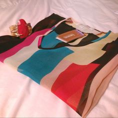 Colorful batwing top Beautiful sheer batwing top with colors of yellow, pink, red, black, peach, and teal. Would suggest wearing a tank underneath also the bottom is high-low style! Brand new with tags but price was peeled off. Francesca's Collections Tops