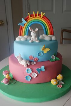 A rainbow cake is fun to look at and eat and a lot easier to make than you might think. Here's a step-by-step guide for how to make a rainbow birthday cake. Fondant Cakes, Cupcake Cakes, Bunny Birthday Cake, Butterfly Birthday, Just Cakes, Novelty Cakes, Love Cake, Sweet Cakes, Pretty Cakes