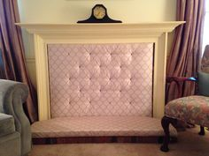 This is a great way to baby-proof a brick surround fireplace that my mom & I came up with. Just cut plywood to size, cover with foam board (for the seat) and batting (for the insert) and then cover with fabric. Add nail brass for decorative interest.