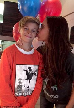 So proud: Victoria Beckham shared a precious snap from son Romeo's celebrations on Tuesday as he marked his 13th birthday