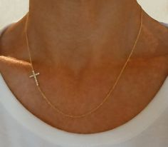 Diamond Sideways Cross Necklace  $360.00. I'm in love with this.