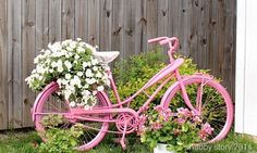 pretty pink bicycle and green plants. 17 Ways to Upcycle A Bicycle - Giddy Upcycled Outdoor Planters, Diy Planters, Planter Ideas, Container Plants, Container Gardening, Bike Planter, Smart Garden, Little Gardens, Bicycle Art