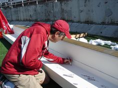Coach Mike Leach signs the final beam to be put in place at The Cougar Football Project