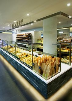 "The bakery corner at ""Fํusion"", a full range food store designed by JHP for AS Watson's ParknShop Supermarkets in Hong Kong - Carefully selected by GORGONIA www. Bakery Store, Bakery Cafe, Cafe Restaurant, Restaurant Design, Bread Display, Bakery Display, Display Case, Bakery Shop Design, Cafe Design"